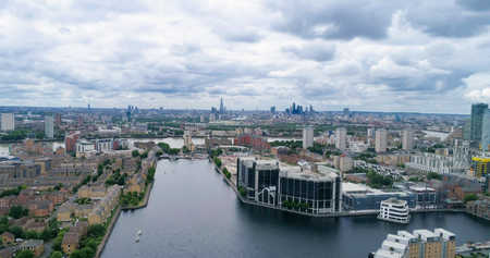sky scraper: Aerial view of the Millwall outer dock in the financial district of the Docklands in London Editorial