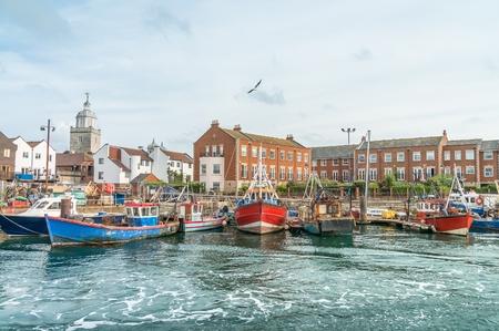Boats in dock in Portsmouth in United Kingdom. Stock Photo
