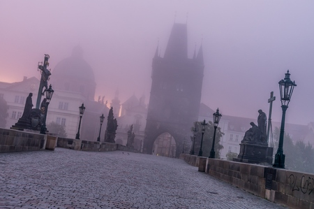 slantwise: Charles Bridge in Prague at foggy morning. Stock Photo
