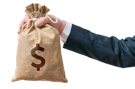 merchant: Hand of businessman holds bag full of money. Isolated on white background. Stock Photo
