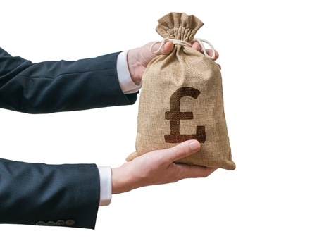 british man: Hands of business man holds bag full of money with British pound sign. Isolated on white background.