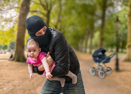 Thief is stealing kidnapped baby from stroller in park. Children kidnapping concept.