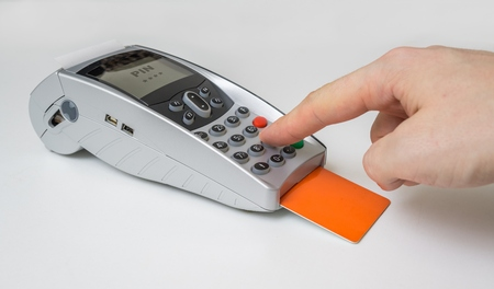Customer is paying using credit card and entering pin in payment terminal.