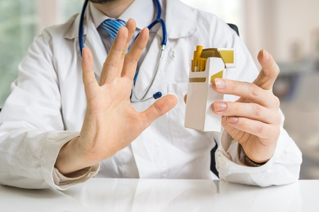 Doctor is warning against smoking cigarettes and giving advice to quit smoking.