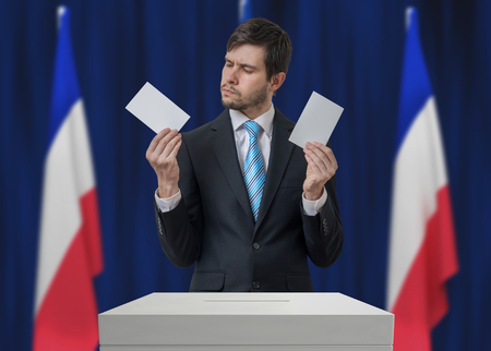 Election in France. Undecided voter is making decision. Stock Photo