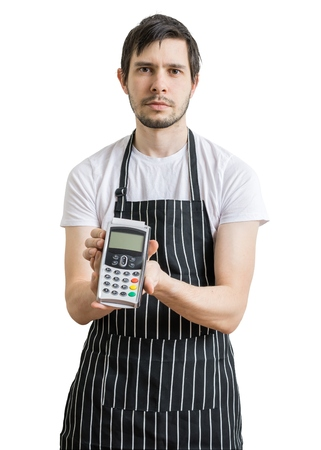 seller: Young man - seller is passing payment terminal for paying with credit card. Isolated on white background.