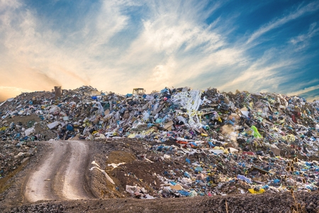 Garbage pile in trash dump or landfill. Pollution concept. Banco de Imagens