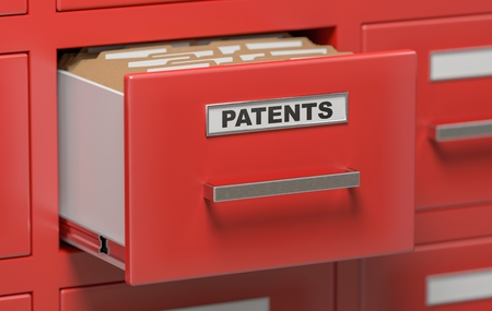 patents: Patent files and documents in cabinet in office. 3D rendered illustration. Stock Photo