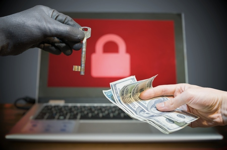Computer security and hacking concept. Ransomware virus has encrypted data in laptop. Hacker is offering key to unlock encrypted data for money.