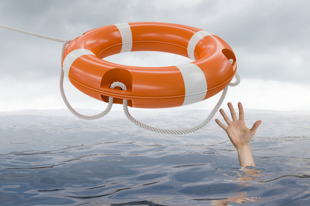life bouy: Man is drowning in ocean and is catching life buoy.