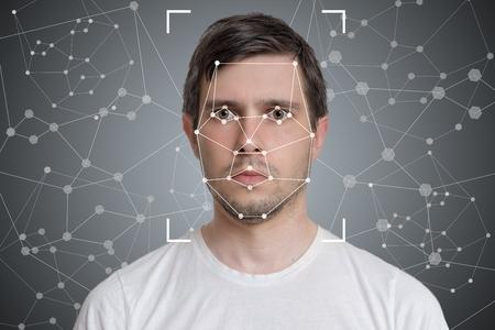 Detección facial y reconocimiento del hombre. Concepto de visión artificial e inteligencia artificial.