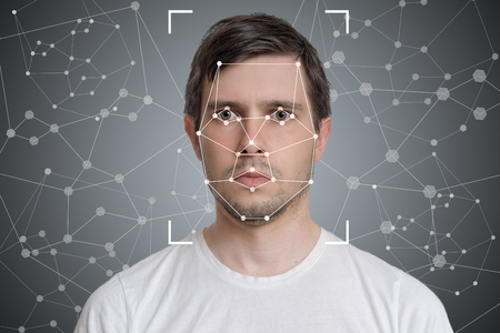 Face detection and recognition of man. Computer vision and artificial intelligence concept.