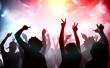 Silhouettes of young people dancing in club. Disco and party concept.