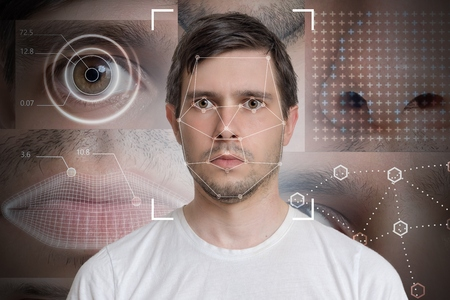 Face detection and recognition of man. Computer vision and machine learning concept. Фото со стока