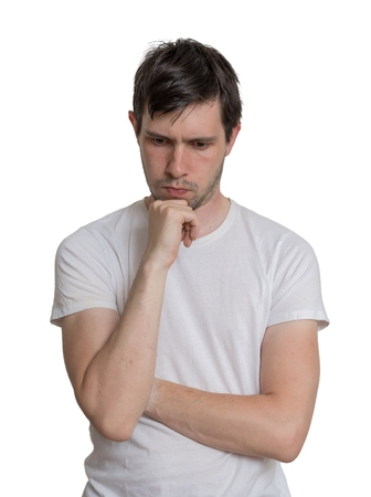 intend: Young man is thinking. Isolated on white background.