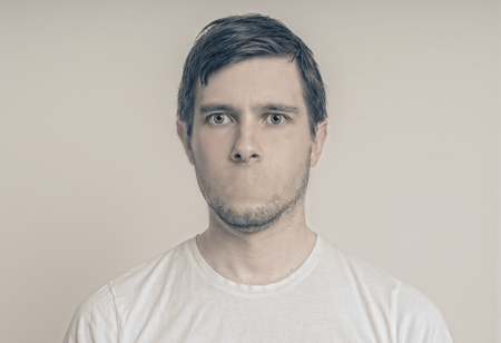 Censorship concept. Face of young man without mouth.