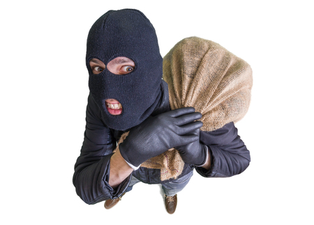 Dief of inbreker draagt zak vol geld. Uitzicht vanaf boven. Geïsoleerd op een witte achtergrond. Stockfoto