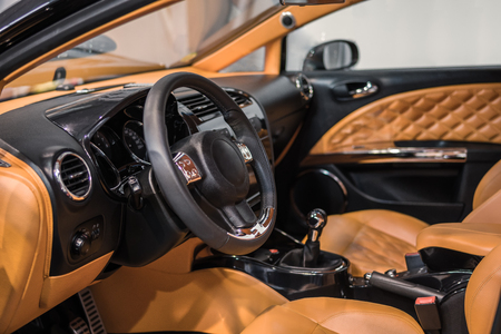 sumptuous: Luxury car Interior - steering wheel, shift lever and dashboard.