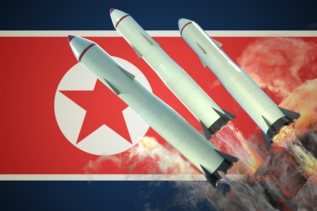 Launch of nuclear missliles. North Korean flag in background. 3D rendered illustration.