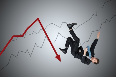 Financial loss and crisis concept. Young businessman is falling down from arrow.