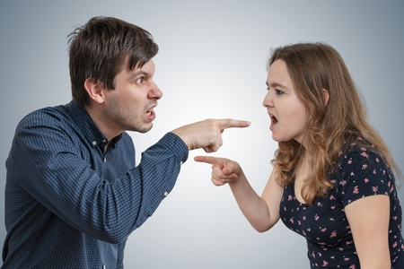 Young couple is arguing and blaming each other.