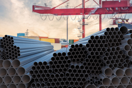 Metallurgy industry concept. Many steel pipes stacked. 3D rendered illustration.
