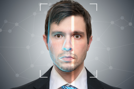 Biometric scanner is scanning face of young man. Detection and recognition concept. 版權商用圖片
