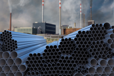 Many steel pipes stacked. Metallurgy industry concept. 3D rendered illustration.
