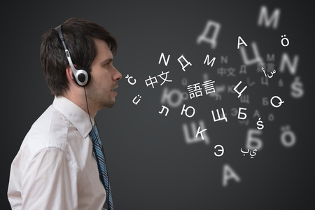 Young man with headphones is speaking in different foreign languages. 版權商用圖片 - 119806285