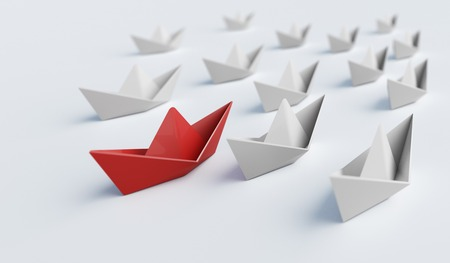 Red paper boat in front of others. Leadership and difference concept. 3D rendered illustration. Reklamní fotografie