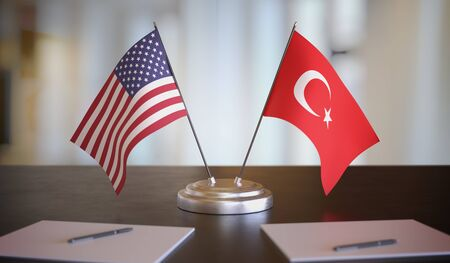 USA and Turkish flags on table. Negotiation between Turkey and United states. 3D rendered illustration.
