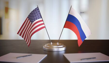 USA and Russian flags on table. Negotiation between Russia and United states. 3D rendered illustration.