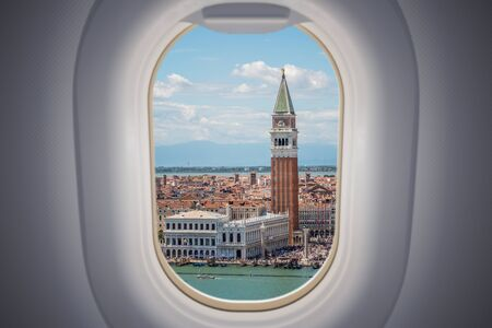 View from airplane window on Venice city in Italy. Stock fotó