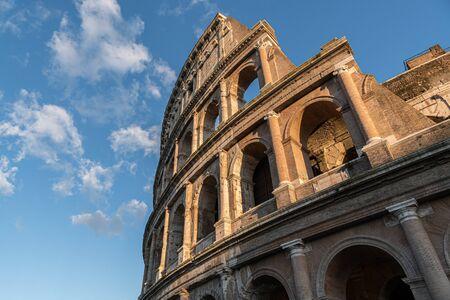 Famous italian landmark Colosseum in Rome at sunset.