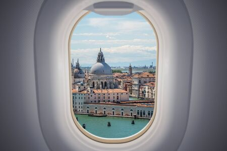View from airplane window on Venice city in Italy. Banco de Imagens