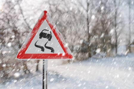 Warning road sign before ice break. Snowy road ad winter.