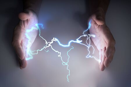 Energy and lightning in hands of healer or magician. Zdjęcie Seryjne