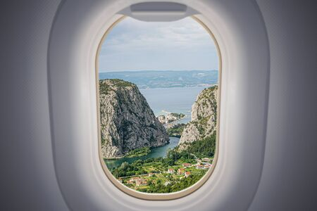 View from airplane window on Omis city in Croatia. Travel and vacation concept. Zdjęcie Seryjne