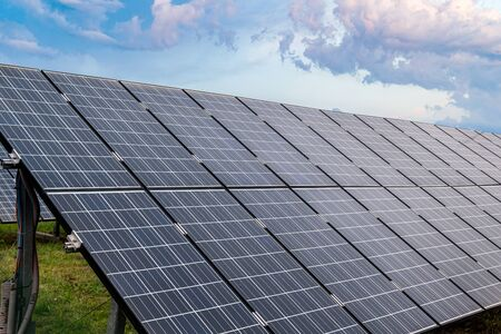 Close-up view on photovoltaic solar panels in power plant.
