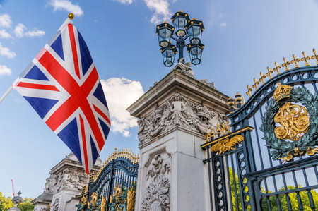 Flag of Great Britain and Buckingham palace in background.