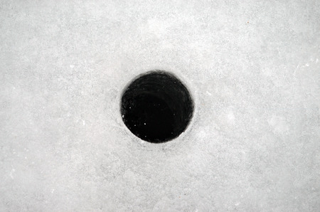 ice fishing: winter fishing. Hole