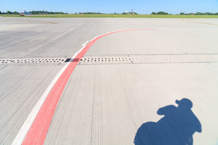guideline: lines and shadows on the runway in airport