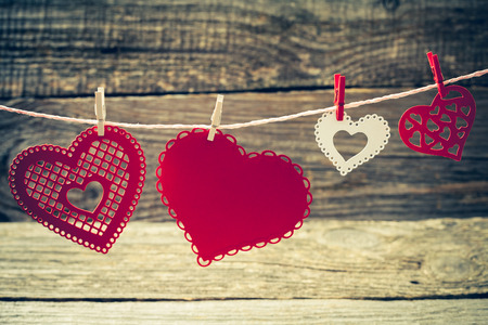 clothes pins: colorful decorative paper hearts on clothes pins