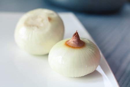 cleared: cleared onion in the plate on the kitchen table