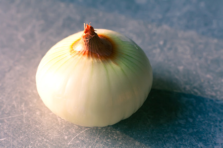 cleared: cleared onion on the grey kitchen table