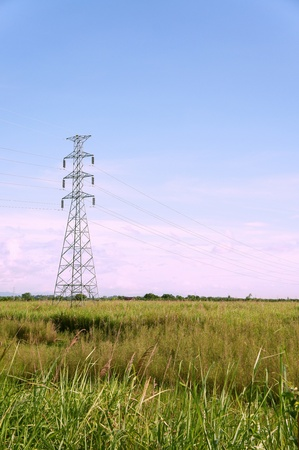 isolator insulator: Electrical tower on a background of the blue sky