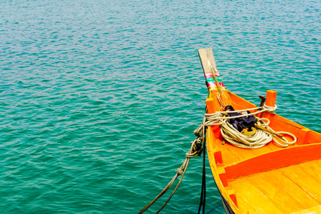 green sea: orange fishing boat on green sea background