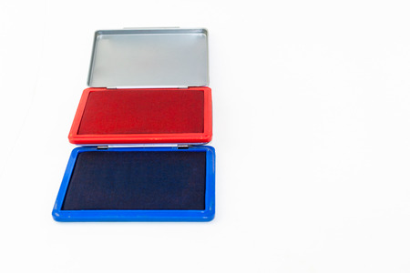 red and blue stamp pad ink isolate on white background photo