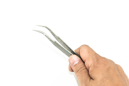 metal tips: hand holding metal tweezers isolate on white background