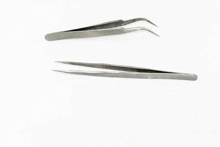grasp: metal tweezers tools isolate on white background